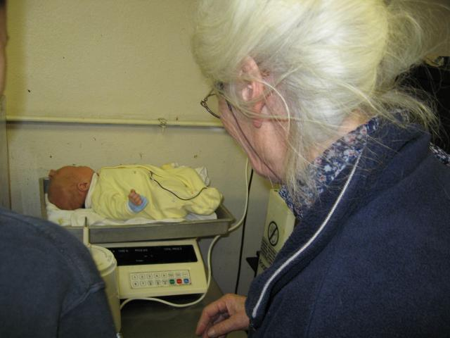 weighing joshua on the bakery scale @ 2 months
