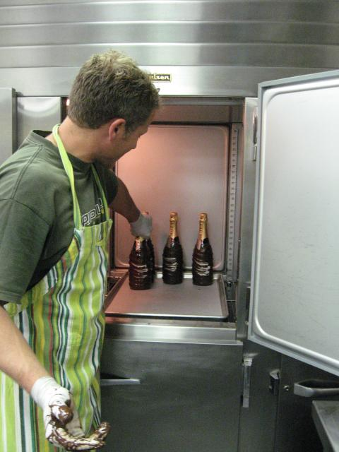 Francois tempering bottles in fridge