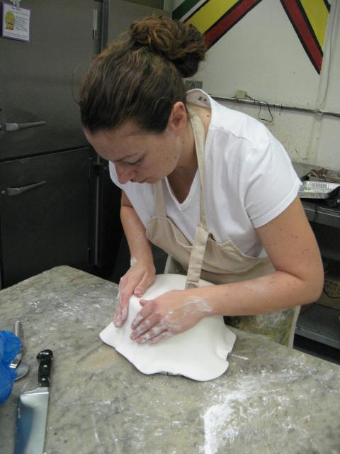Covering cake with fondant